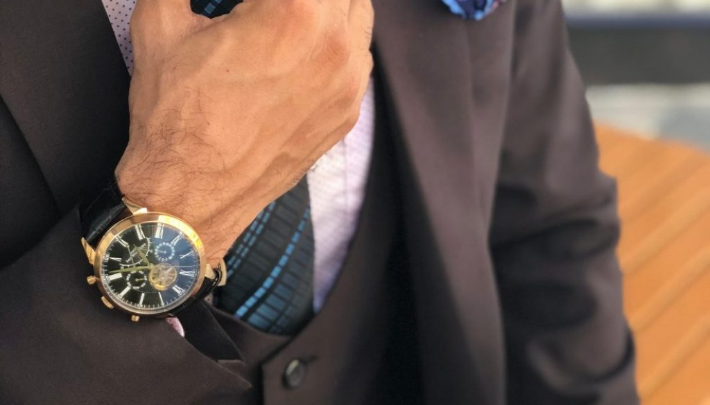 man-in-formal-suit-jacket-holding-his-necktie-1342609